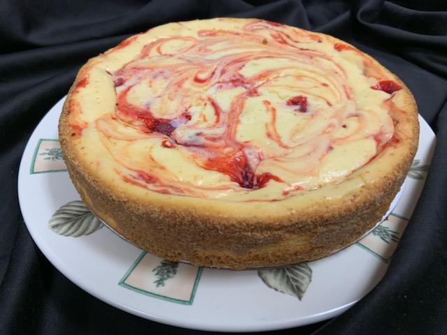 Red raspberry swirl cheesecake